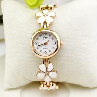 2014 Women waterproof bracelet white personalized rhinestone vintage four leaf grass watch female