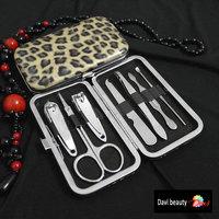 7pcs Leopard Pattern Stainless steel Nail Art Manicure Set with Scissor Tweezer Knife Ear pick Utility + Travel Mini Nail Cutter
