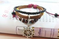 Wholesale-12pcs/lot Pirates of the Caribbean jewelry fashion leather bracelets