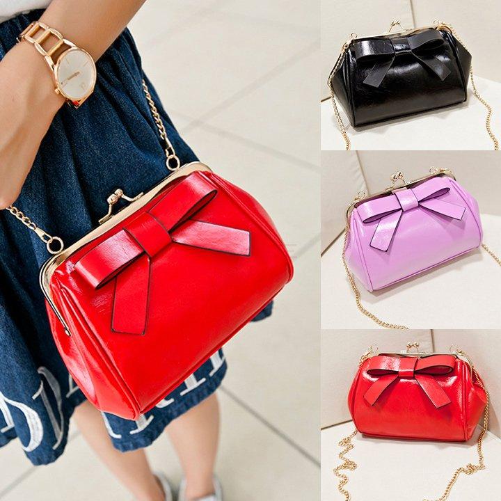 Women Shoulder Bags 2015 New Fashion Women Handbag bolsos Bowknot metal belt Cross Bag Tote Candy Color Small Clutch Bag bolsas(China (Mainland))