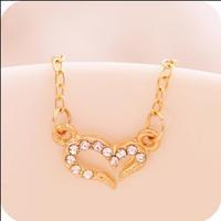 OMH wholesale 6pcs off 45% = $0.32/pcs Golden Silver Fashion Heart Crystal Pendant Alloy Link Chain Women Necklace XL141