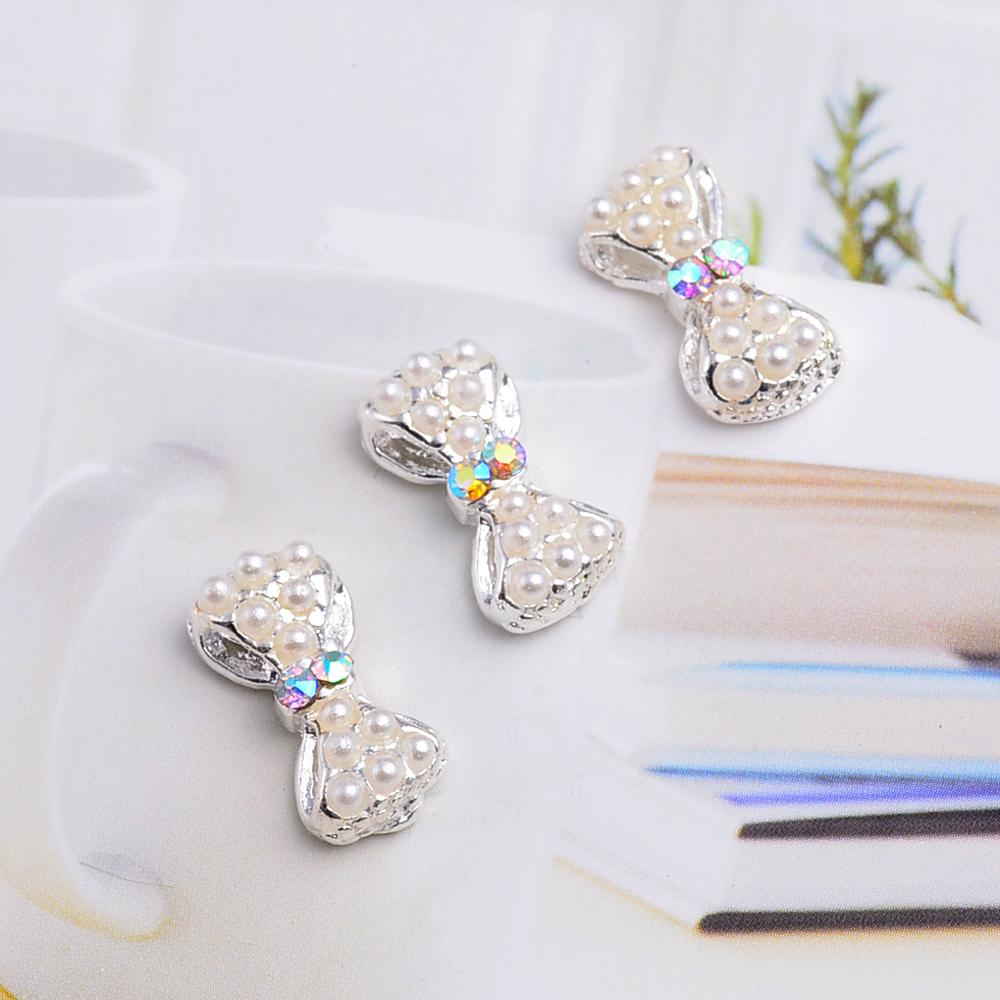 10Pcs New 2015 Pearl Nail Bow,3D Metal Alloy Nail Art Decoration/Charms/Studs,Nails Rhinestones 3d Jewelry Supplies TN076(China (Mainland))