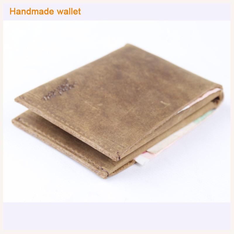 Canada hot sale retro leather slim wallet men handmade craft simple magic male bifold purse ultra sleeve wallet 2 card holder(China (Mainland))