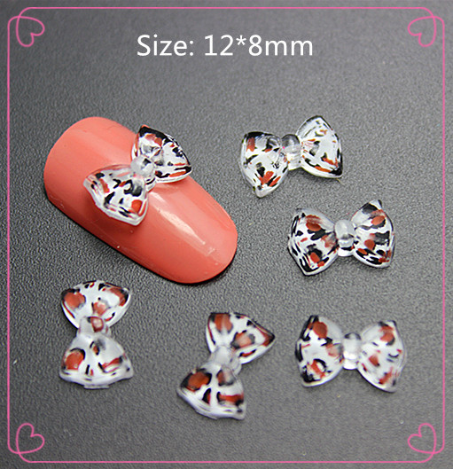 12*8mm 100pcs/lot clear leopard print resin bow flat back cabochon for DIY nail beauty decoration,(China (Mainland))