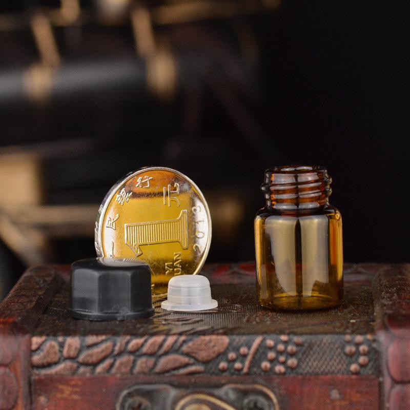 2ml transparent brown bottle liquid vials containing essential oil cosmetic trial