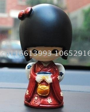 Q version of the Japanese geisha doll shook his head doll car solar toy car ornaments spring interior free shipping!(China (Mainland))