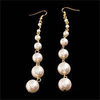 Long large white pearl earrings