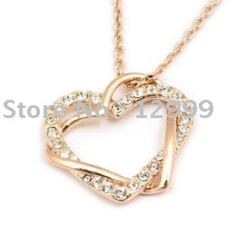free shipping heart shape unique design alloy crystal pendant necklace(China (Mainland))