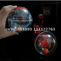 Mini hand-held basketball/shooting machine