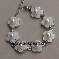 ASB100573 Fashion flower bracelet jewelry made from 5-6mm freshwater pearl and shell carving