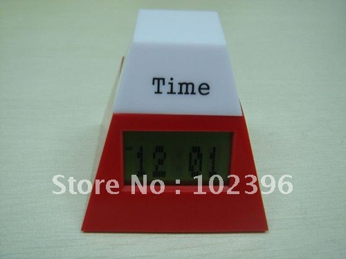 Factory Price Table LCD clock with 7-colors flashing light Pyramid figure design Suitable for offices and house stores(China (Mainland))