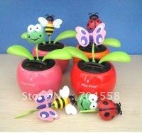 Free shipping via EMS 30pcs per lot solar dancing flower no battery no water the leaves flip flap under sunshine