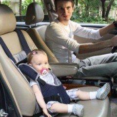 Young children car sits bag
