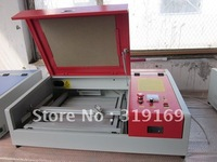 jinan sell cheap laser 4030 engraving/ cutting machine