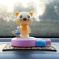 lovely cartoon Dolls solar energy cat Car trim animal jubilance car seat covers and accessories