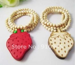 Free shipping 2012 wood strawberry lady necklace fashion hip hop style grass tree beads necklace mix color sold per 12pcs(China (Mainland))