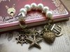 Min order is 20$(Mixed order)Popular trendy bracelet  Free shipping  2013 Pearl elastic starfish sailor bracelet