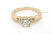 MIN.ORDER $15,fashion gold plated ring with a crystal inset and two small ones around