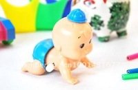 Wind-up toys - on the chain shaking his head crawling doll
