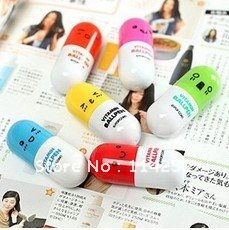 FreeShipping 2013 Office supplies Retractable pen/Ball point cartoon Telescopic face Capsule pills Pen(China (Mainland))