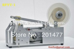 Self-adhesive semi-auto labeling machine for round bottle(China (Mainland))