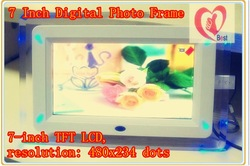 free shipping7 inch digital photo frame, view the pictures , play MP3 &Movie(China (Mainland))