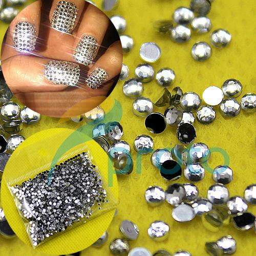 Украшение ногтей камнями