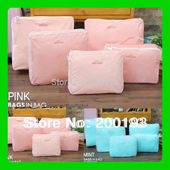 SMILE MARKET Hot!!! 5pieces/set/lot Novelty Magic Multifunctional Storage Travel bag storage (Color: Gray,Red,Blue,Pink)