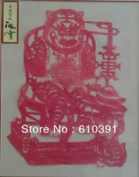 Chinese traditiona; paper cut  of tiger  and dog