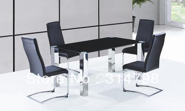 Mesa de comedor cristal con patas de acero inoxidable for Sillas de acero para comedor