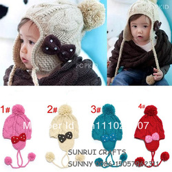 handmade baby earflaps hat with bowknot hand-knitted kids pearl hat baby crochet bowknot flower hat(China (Mainland))