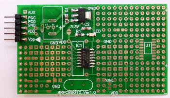 Microchip 14-pin PIC16F676-I/SL microcontroller with experimental board development board test board