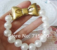 Free shipping Min order  $10(mixed order) Fashion  bowknot Pure manual string of pearls  elastic bracelet P002