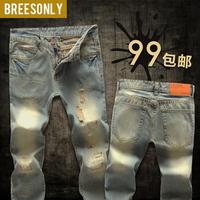 Personality hole jeans male beggar pants retro finishing slim long trousers denim patch men's