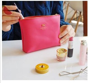 FREE SHIPPING! 5583 solid color zipper metal butterfly knot cortex cosmetic bag portable hand finishing storage(China (Mainland))