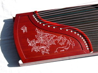 Guzheng gold phoebe mahogany carved playing guzheng