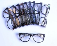 Dollar print legs and different print with black frame glasses with clear lenses