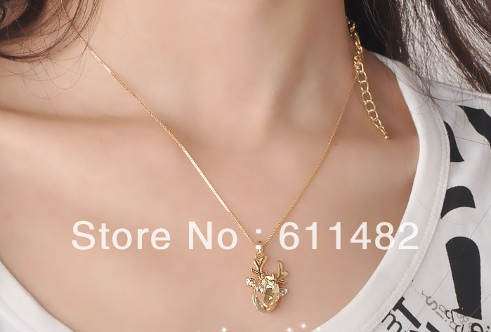 Min.order is $10(mix order) 1pcs/lot Big gem deer fawn necklace chain champagne crystal head to collarbone free shipping(China (Mainland))