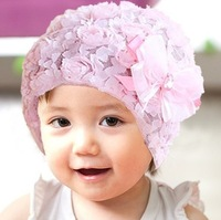 12Pcs/lotFreeshipping!! New baby infant girls hat flower winter/ girl's lace bowknot spring beanies cap pink / Wholesale