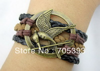 Free Shipping 12pcs/lot Handmade Braided Leather Cord Bracelet The Hunger Games bird Charm Bracelet UN24091