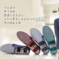 Cotton vintage vulcanized shoes low foot wrapping shallow mouth round toe flat heel rubber sole transpierce stripe women's shoes