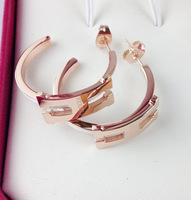 Foreign trade rose gold plated titanium steel letter and silver fashion earrings