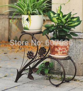 New iron flower pots rack balcony indoor flower racks for Garden accessories online