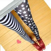 Stars 2013 autumn street snap asymmetric black and white stripe splicing milk silk leggings free shipping