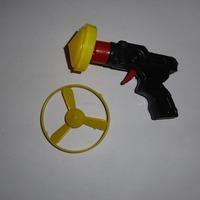 Spinning top gun small toy gun brick toy