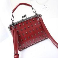 2014 new  women's spring handbag vintage messenger bag preppy style rivet bag skull one shoulder cross-body clip small bag