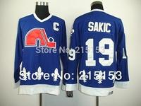 Wholesale Men's Ice Hockey Jersey Quebec Nordiques Sakic  #19 Joe Sakic Dark Blue Authentic CCM Throwback Ice Hockey Jersey