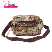 2014 fashion brand jacquard cloth with ms head layer cowhide bag, inclined shoulder bag, multi-function bag, free shipping