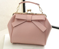 The new 2014 European and American fashion retro leather bowknot clip mouth one shoulder bag portable aslant leisure bag