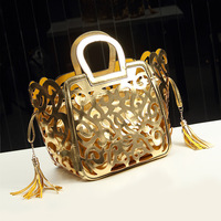 Hollow tassel bag handbag  new European and American fashion handbags candy colored bags PIP package tide 40*27*18 CMNBD105 Y8PB